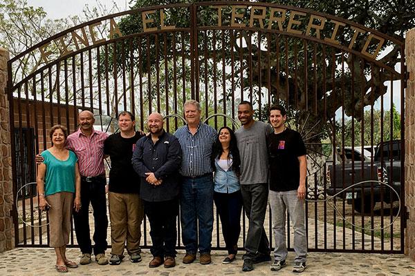 PJ's Coffee team outside the entry gate of the Finca Terrerito farm
